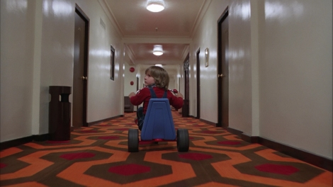 Nothing at all creepy about a boy riding his bike down a completely deserted hotel hallway.